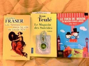 Les Femmes dans la Vie de Louis XIV by Antonia Fraser, Le Magasin des Suicides by Jean Teule and Le Tour du Monde en Quatre-Vingts Jours by Jules Verne