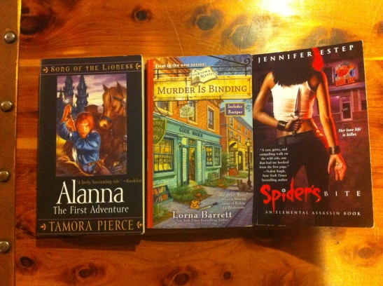 Alanna: The First Adventure by Tamora Pierce, Murder is Binding by Lorna Barrett and Spider's Bite by Jennifer Estep