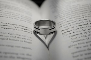 Ring on book with heart shaped shadow